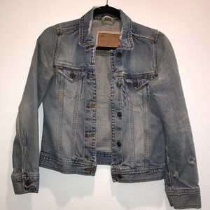Light washed distressed jean jacket